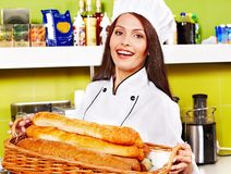 Female chef holding  food. Stock Photo