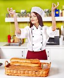 Female chef holding  food. Royalty Free Stock Photo