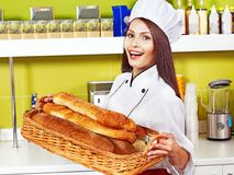 Female chef holding  food. Royalty Free Stock Photos