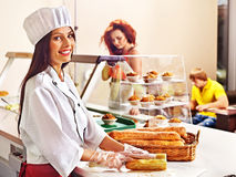 Female chef holding  food. Royalty Free Stock Photography