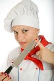 Female chef holding kitchen knife Royalty Free Stock Photography