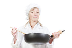 Female chef holding pan. Royalty Free Stock Photo