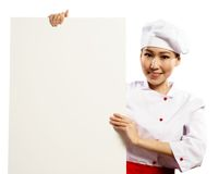 Female chef holding a poster for text Stock Image
