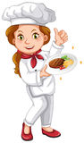 Female chef holding signature dish Royalty Free Stock Image