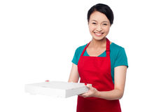 Female chef holding white pizza box Royalty Free Stock Photo
