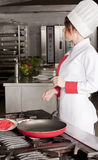 Female chef in kitchen Royalty Free Stock Photos