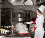 Female chef in kitchen stock photography