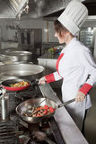 Female chef in kitchen Stock Photo