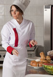 Female chef in kitchen. Portrait of mid adult female chef in kitchen Stock Image