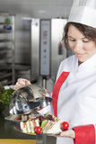 Female chef in kitchen Stock Photos