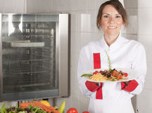 Female chef in kitchen royalty free stock images