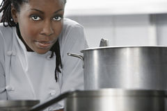 Female Chef In Kitchen. Closeup of an African American female chef in the kitchen royalty free stock photography