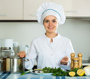 Female chef in kitchen Stock Photo