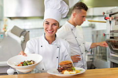 Female chef in kitchen Stock Image