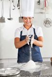 Female Chef Kneading Dough Stock Photo