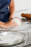 Female Chef Kneading Dough Royalty Free Stock Photography