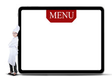 Female Chef Leaning on The Menu Board Royalty Free Stock Images