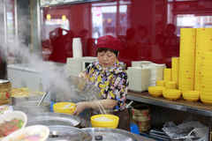Female chef making chinese traditional noodle royalty free stock photos