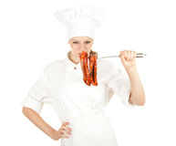 Female chef with meat, series Stock Images