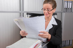 Female chef in the office with a lot of papers Stock Photos