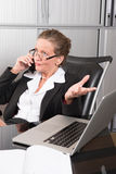 Female chef in the office on the phone Royalty Free Stock Photo