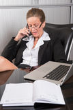 Female chef in the office on the phone Royalty Free Stock Images