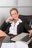 Female chef in the office on the phone Royalty Free Stock Image