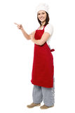 Female chef pointing towards copy space area Royalty Free Stock Photo