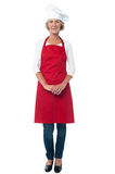 Female chef posing over white stock photography