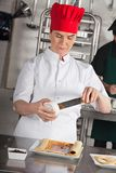 Female Chef Preparing Chocolate Roll Royalty Free Stock Photography