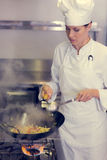 Female chef preparing food in kitchen Stock Photography