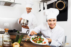 Female chef preparing fresh salad Stock Photography