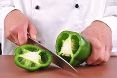 Female chef preparing green paprika Stock Photography