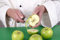 Female chef preparing a pear Royalty Free Stock Image
