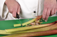 Female chef preparing some rhubarb Royalty Free Stock Photography
