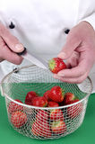 Female chef preparing some strawberries Stock Photography