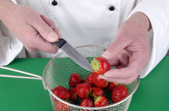 Female chef preparing some strawberries Royalty Free Stock Image
