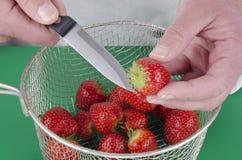 Female chef preparing a strawberry Stock Photo