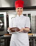 Female Chef Presenting Chocolate Cake Stock Photography