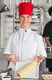 Female Chef Presenting Chocolate Roll Stock Photography