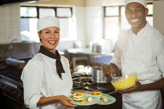 Female chef presenting dessert plates Royalty Free Stock Photo