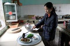 Female chef process fried cicadas Stock Images