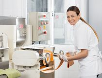 Female Chef Processing Spaghetti Pasta Sheet In Royalty Free Stock Image