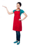 Female chef promoting bakery product Royalty Free Stock Photography