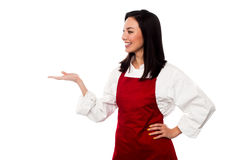 Female chef promoting bakery product Royalty Free Stock Photos