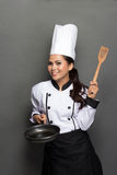 Female chef ready to cook Royalty Free Stock Images