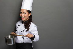 Female chef ready to cook Stock Photos
