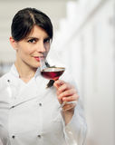 FEMALE CHEF WITH RED WINE GLASS Royalty Free Stock Photos