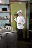 Female chef in restaurant. Chef working in restaurant standing at kitchen doorway stock photos