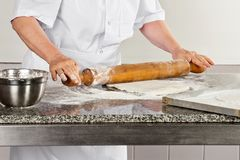 Female Chef Rolling Dough Stock Photos